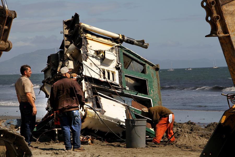 Boat Wreckage, Beach in Santa Barbara, California, after the storm, cleaning up