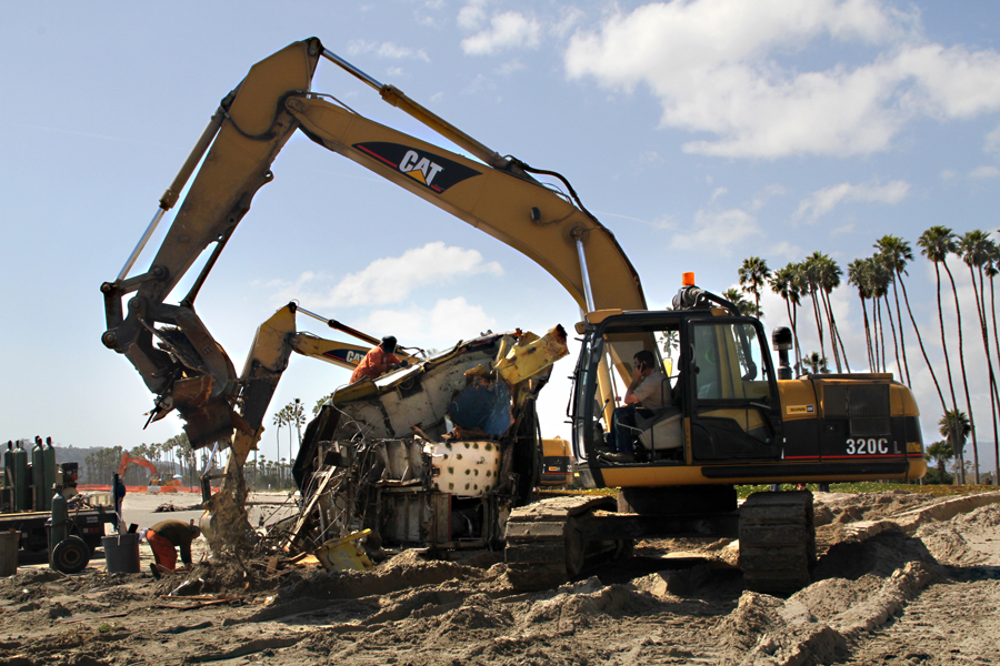 Digging on the Beach in Santa Barbara, California,  cleaning up