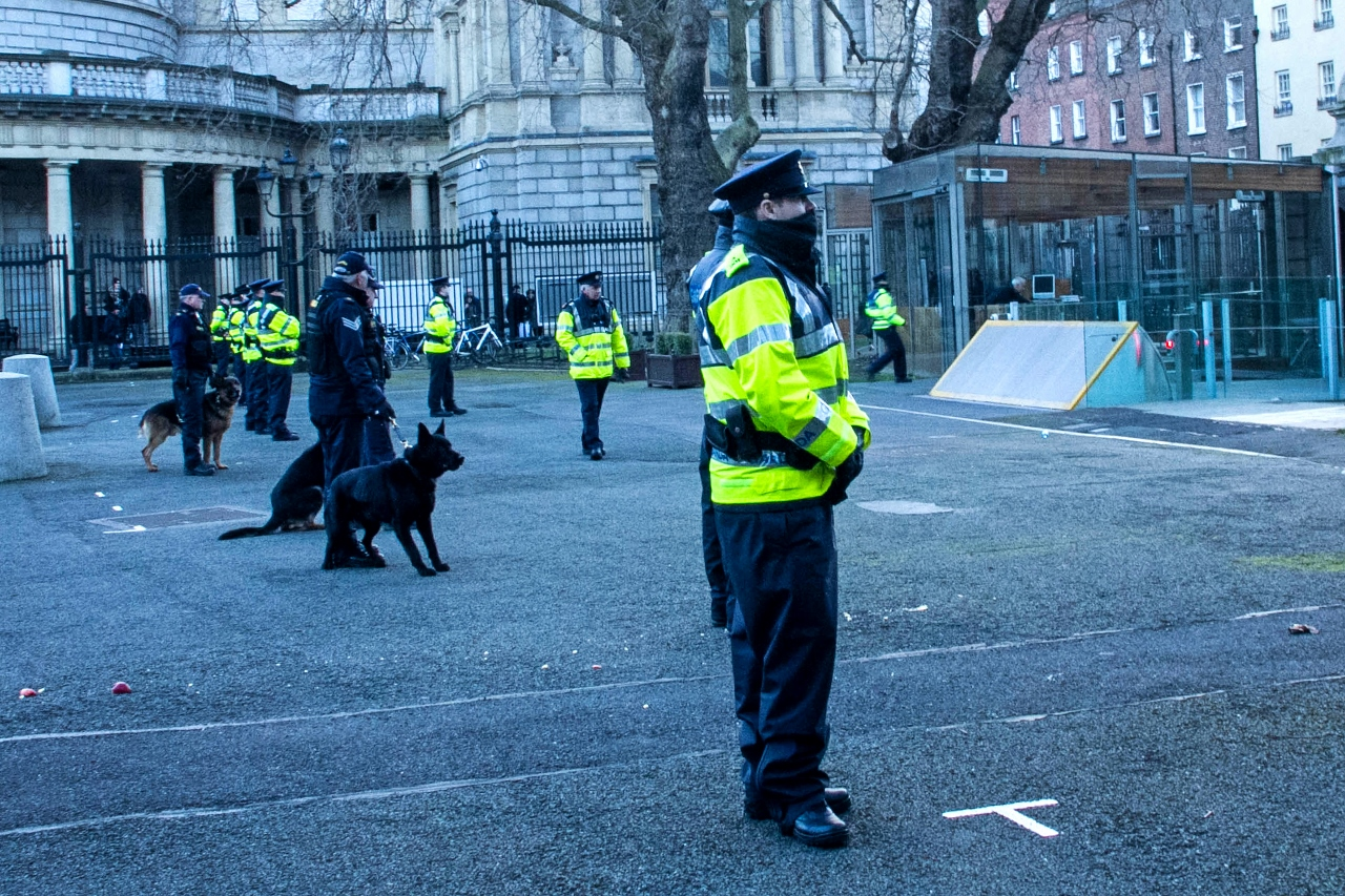 Garda and dogs waiting for Water Protesters by Julie Miche travel blogger