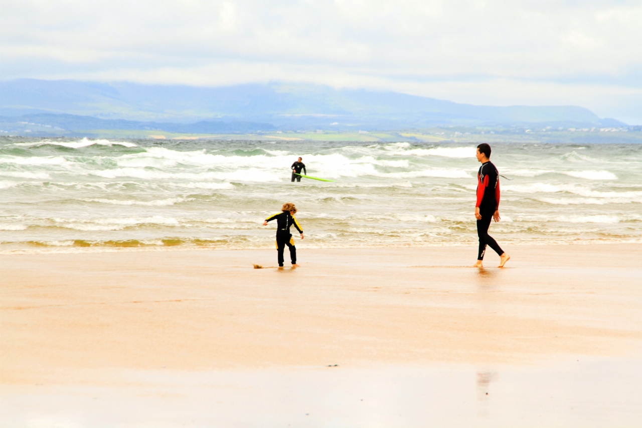 Surf, swim, play in the water, Bundoran Ireland by Julie Miche