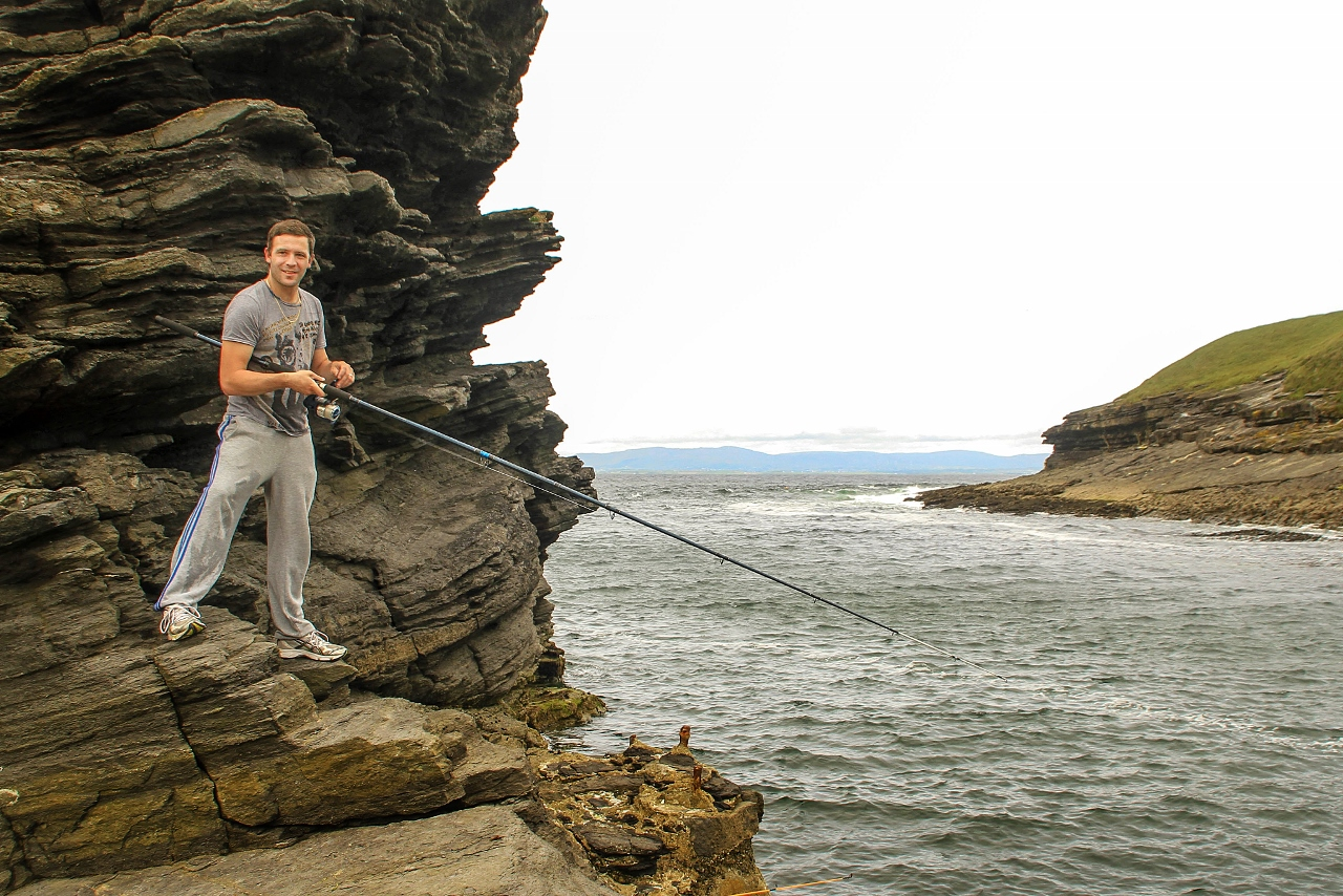 Shoreline fishing in Bundoran, Ireland by Julie Miche