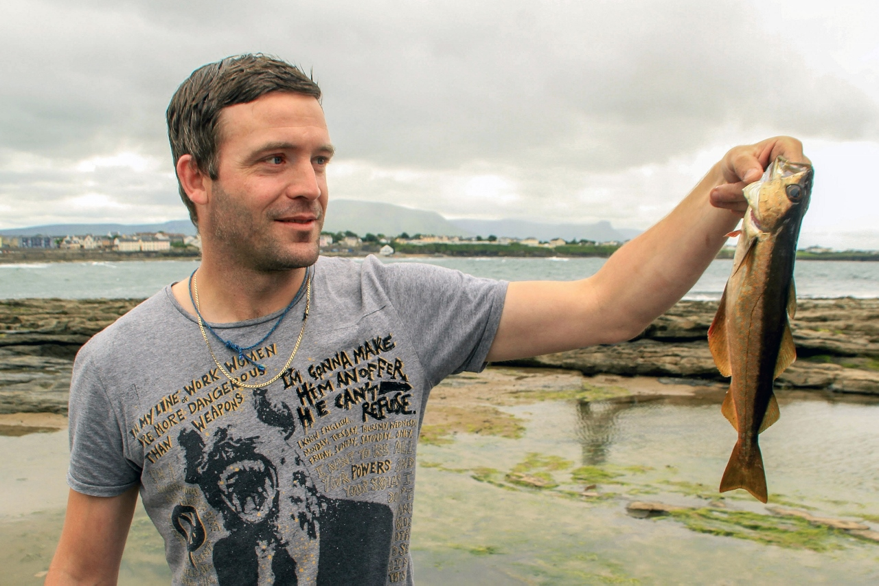 Catching fish in Bundoran, Ireland from the shore by Julie Miche