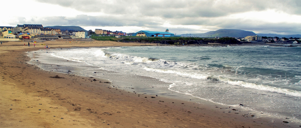 Walk the beach right at the edge of town in Bundoran, Ireland by Julie Miche